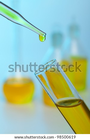 Photo of bio fuel drop on blue background - stock photo
