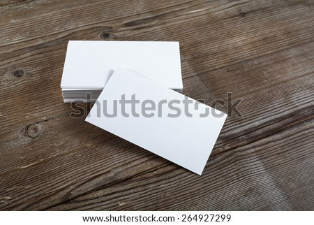 Photo of blank business cards on a wooden background. Template for ID. Top view. - stock photo