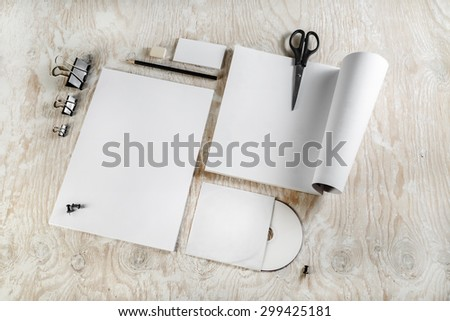 Photo of blank stationery. Corporate identity template on light wooden background. For design presentations and portfolios. - stock photo