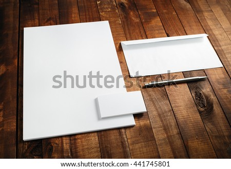 Photo of blank stationery set. Blank template for branding identity. Blank letterhead, business cards, envelope, and pen. Mock-up for branding identity for designers. - stock photo