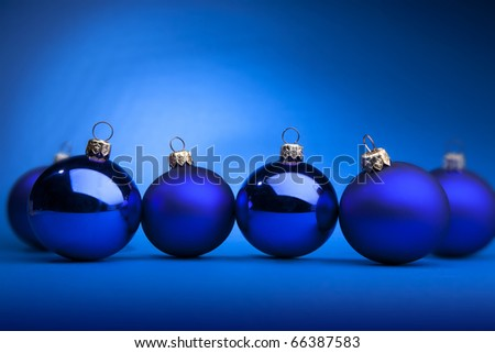 Photo of blue Christmas balls on a blue background - stock photo