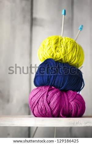 Photo of blue, purple and yellow balls of wool - stock photo