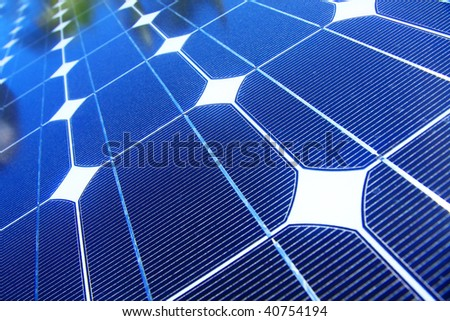 photo of blue solar panels on a roof - stock photo