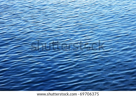 Photo of blue water background surface with ripples - stock photo
