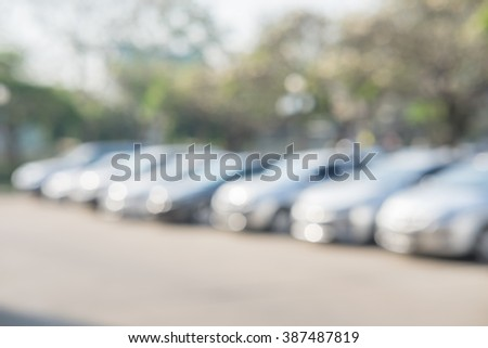 Photo of blurred parking cars in the city - stock photo