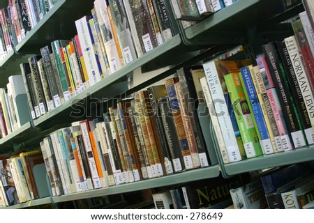 Photo of books on a shelf at the library.