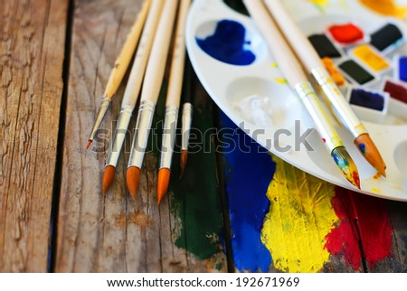Photo of  brush mixed paint on the palette  - stock photo
