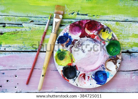 Photo of  brushes and acrylic colors - stock photo