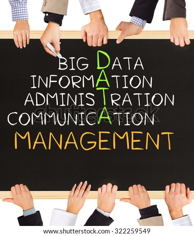 Photo of business hands holding blackboard and writing DATA management concept - stock photo