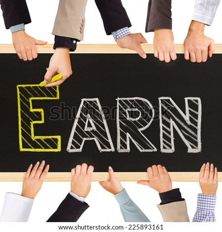 Photo of business hands holding blackboard and writing EARN concept - stock photo