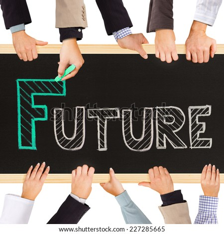 Photo of business hands holding blackboard and writing FUTURE concept - stock photo