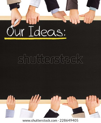 Photo of business hands holding blackboard and writing Our Ideas - stock photo