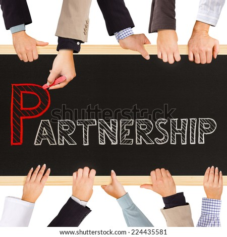 Photo of business hands holding blackboard and writing PARTNERSHIP concept - stock photo