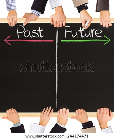 Photo of business hands holding blackboard and writing timeline with Past and Future - stock photo