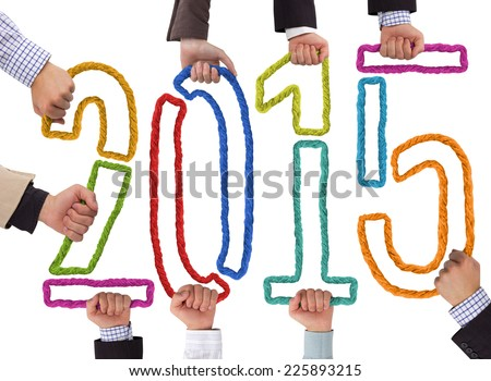 Photo of business hands holding bricks forming year 2015 - stock photo