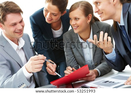 Photo of business partners showing document to their boss at meeting - stock photo