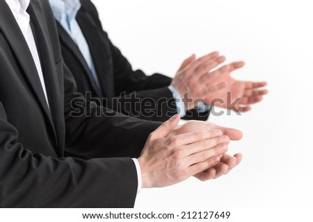 Photo of business people hands applauding at white background. Photo of business partners hands applauding at meeting  - stock photo