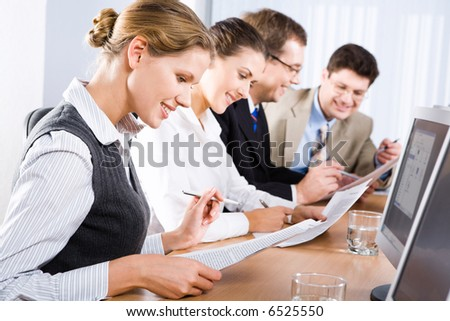 Photo of business people reading a text in the classroom