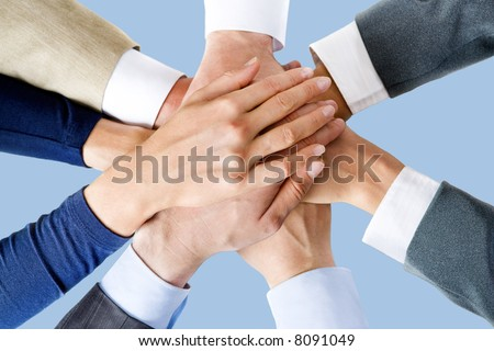 Photo of business people's hands on top of each other - stock photo