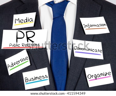 Photo of business suit and tie with PR concept paper cards - stock photo