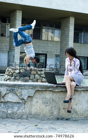 photo of business woman and street dancer - stock photo