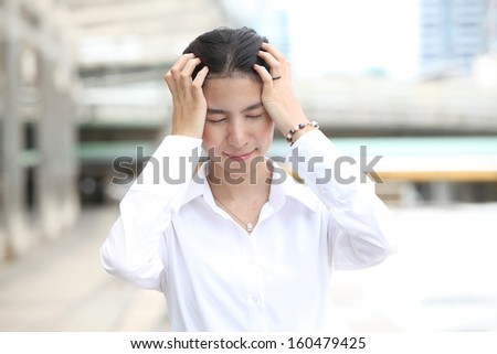Photo of business woman having a headache