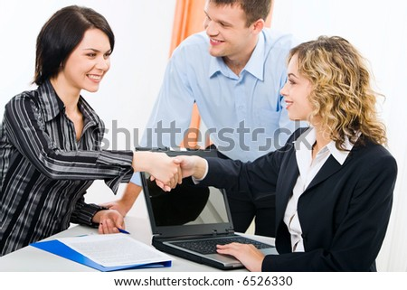Photo of business women shaking hands at meeting - stock photo