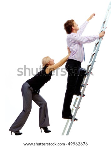 Photo of businessman ascending the ladder with pretty woman helping him - stock photo