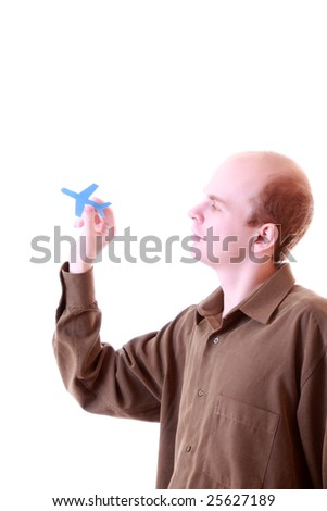 Photo of businessman holding paper aircraft - stock photo