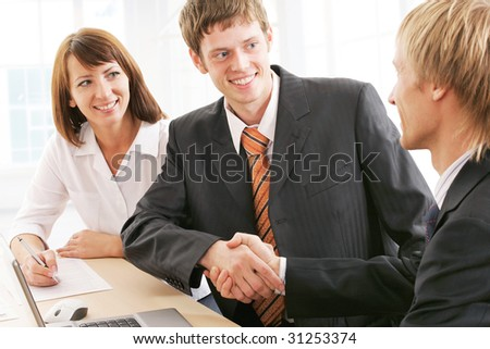 Photo of businessmen  handshaking with woman near by - stock photo