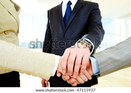 Photo of businesspeople? hands on top of each other - stock photo