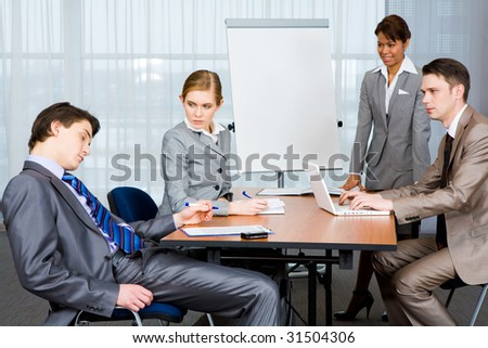 Photo of businesspeople looking sternly at their sleeping colleague at presentation - stock photo