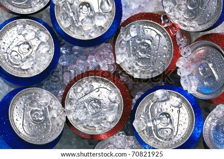 Photo of cans of drink on crushed ice. - stock photo