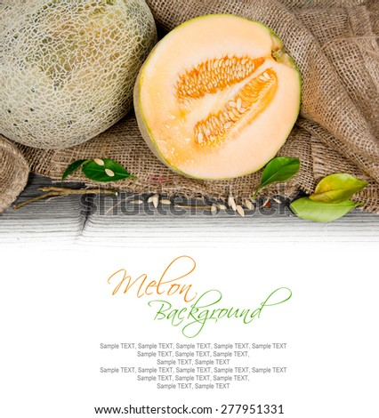 Photo of cantaloupe melon with slice and leaves on burlap with white space - stock photo