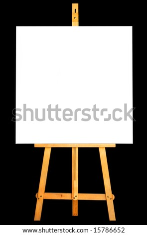 Photo of canvas and easel isolated in black background - stock photo