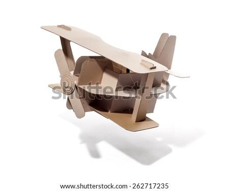 Photo of  cardboard plane on white background. Biplane. - stock photo