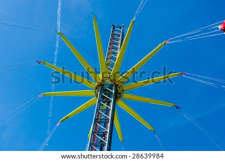 Photo of Carousel in funfair in sunny day