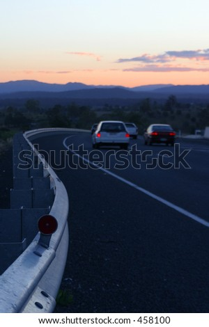 Photo of cars on the road at dusk.