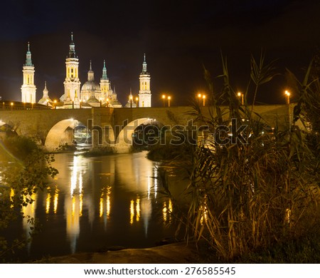 Photo of Cathedral and Ebro  in night. Zaragoza, Spain
