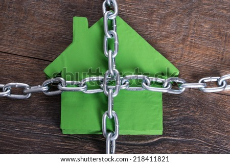 Photo of chained home in privacy concept - stock photo