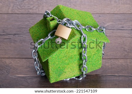 Photo of chained house for security concept - stock photo