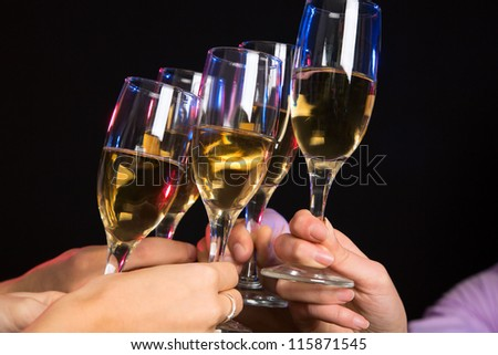 Photo of champagne glasses during toast at party - stock photo