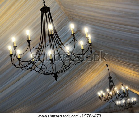Photo of chandeliers on an tent's ceiling in a wedding party - stock photo