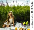 Photo of charming little girl at picnic - stock photo