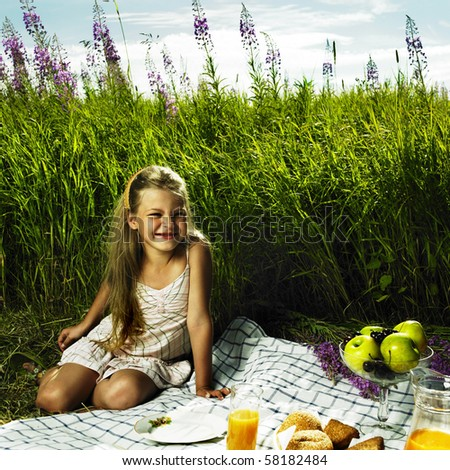 Photo of charming little girl at picnic