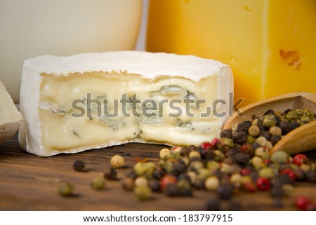 Photo of cheese and pepper on wooden board