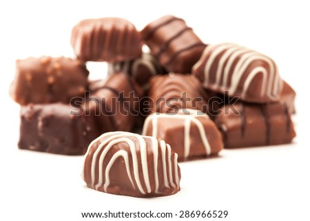 Photo of chocolate pralines over white isolated background - stock photo