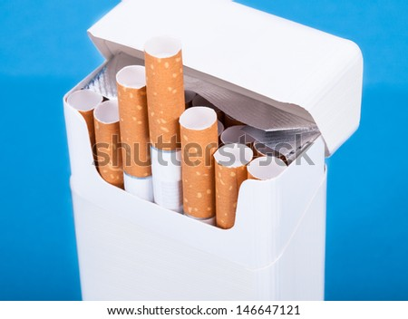 Photo Of Cigarettes In Pack Over Blue Background