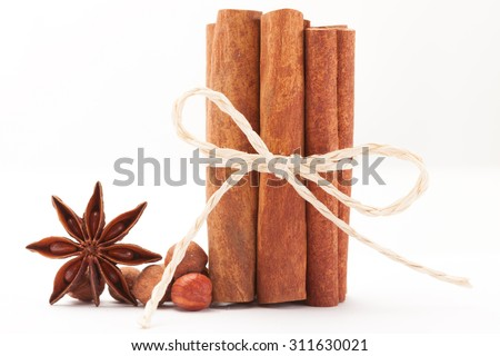 Photo of cinnamon sticks and star anise over white isolated background - stock photo