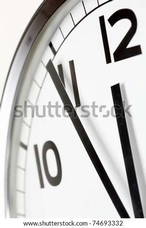 Photo of clock showing five minutes to noon - stock photo